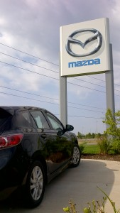 Mazda car and sign